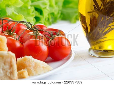 Italian Food Ingredients On White Wooden Table