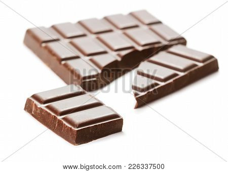 Close-up View Of Broken Chocolate Bar Isolated On White Background