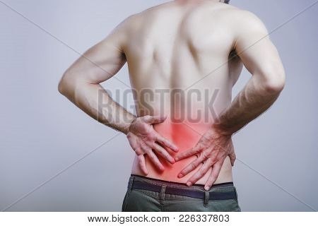 Young Caucasian Man Experiencing Lower Back Pain
