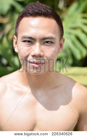 A Portrait Of A Topless Asian Chinese Man Under The Sun