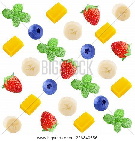 Colorful Fruit Pattern Of Fresh Strawberry, Banana, Mango , Blueberries And Mint Slices On White Bac