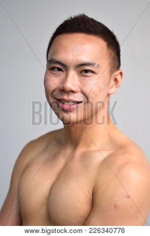 A Portrait Of A Topless Asian Chinese Male