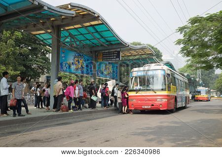 Hanoi, Vietnam - Oct 25, 2015: Bus Station With Line Of People Waiting For Bus In Hanoi City