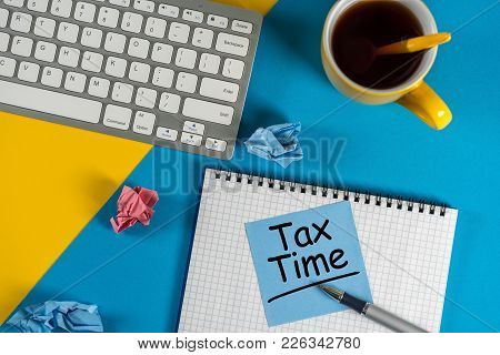 Tax Time - Accauntant Or Businessman Workplace With Notification Of The Need To File Tax Returns, Ta