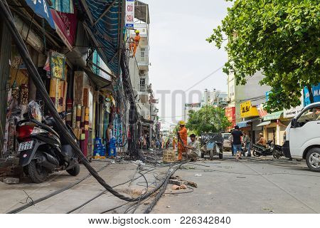 Hanoi, Vietnam - June 14, 2015: Workers Fix Damaged Telecommunication Cables After Super Heavy Wind