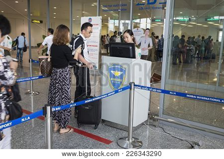 Hanoi, Vietnam - June 26, 2015: Line Of People Queue At Departure Gate At Noi Bai International Airp