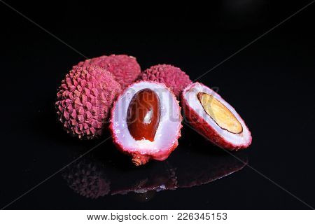 Lychee Or Litchi Litchies Or Lychees On Black Reflective Studio Background. Isolated Black Shiny Mir