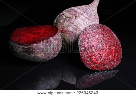Beetroot Beet On Black Reflective Studio Background. Isolated Black Shiny Mirror Mirrored Background