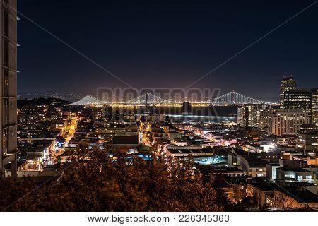 Amazing Night Cityscape Of Illuminated San Francisco In California Usa. Panoramic Long Exposure Phot