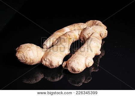 Ginger. Whole Ginger On Black Reflective Studio Background. Isolated Black Shiny Mirror Mirrored Bac