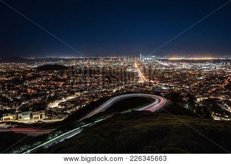 Majestic Night Cityscape Of Illuminated San Francisco In California Usa. Panoramic Long Exposure Pho