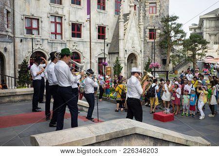 Da Nang, Vietnam - Apr 2, 2016: Street Musician Group In Ba Na Hills Mountain Resort, The Multi-leve