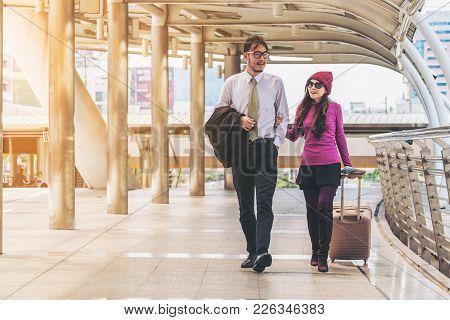 Couple Travellers Walking In Airport Walkway