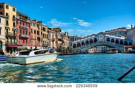 Venice, Italy - May 21, 2017: Beautiful View Of Old Buildings, Gondolas, A Vaporetto, A Boat And The