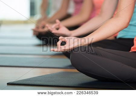 Group Of People Practicing Yoga Class, Hands Closeup Background, Sport And Healthy Lifestyle, Wellne