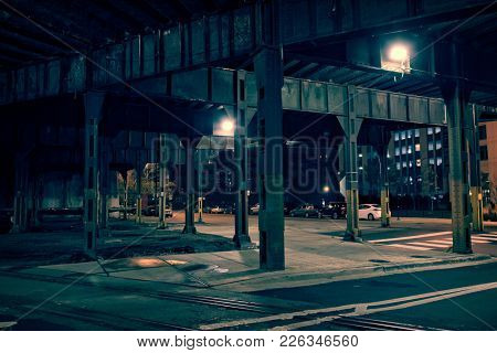Dark city tunnel street and alley at night.