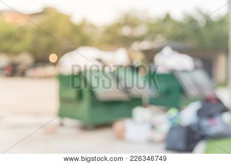 Overflowing Dumpster At Apartment Building Yard In America