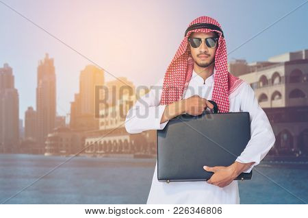 Arabian Man Holding Business Briefcase.