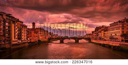 Florence, Italy - May 19, 2017: Beautiful View Of Saint Trinity Bridge From Ponte Vecchio At Sunset