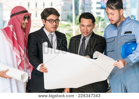 Engineer, Businessmen And Arab Man Meeting About Construction Drawing Discussion. Multicultural Over