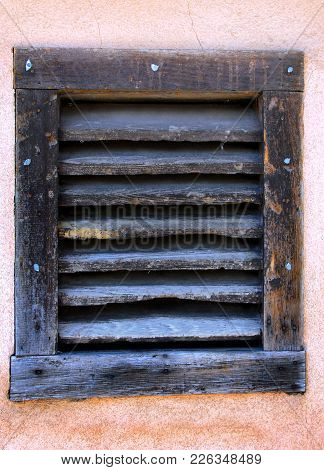 Old, Weathered And Worn Board Window Sits In An Adobe Wall In Santa Fe, New Mexico.  Boards Are Very