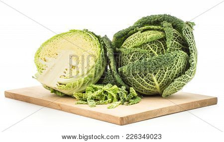 Savoy Cabbage On A Chopping Board Isolated On White Background One Fresh Green Head One Section Half