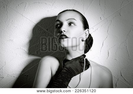 Beauty Fashion Glamorous Model Female Portrait. Vintage Style Mysterious Woman Wearing Glamour Glove