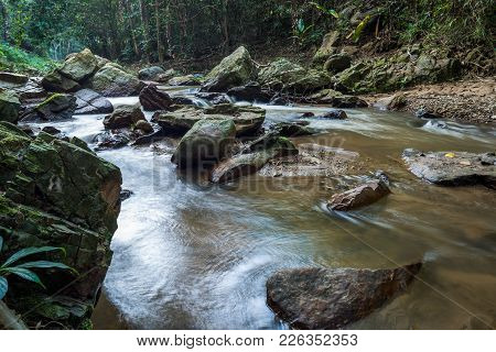 Long Exposure Technique For Waterfall In River That Flow From High To Low Point In National Park In