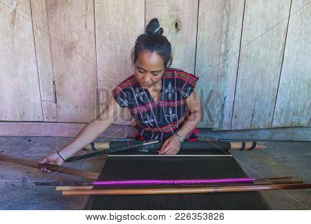 Quang Nam , Vietnam - Oct 07 : Woman From The Cotu Minority Weaves With A Strap Loom In Quang Nam Vi