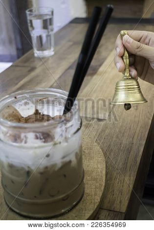 Hand On Brass Bell In Coffee Shop, Stock Photo