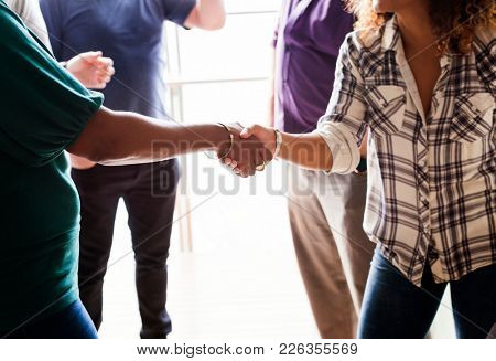 Diverse woman shaking hands