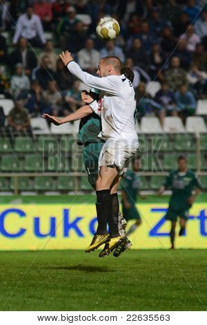 KAPOSVAR, HUNGARY - JULY 30: Unidentified players in action at a Hungarian National Championship soccer game - Kaposvar (green) vs Videoton (white) on July 30, 2011 in Kaposvar, Hungary.