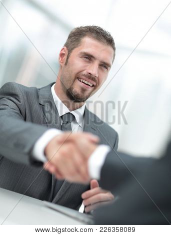 closeup .the Manager shakes hands with the client