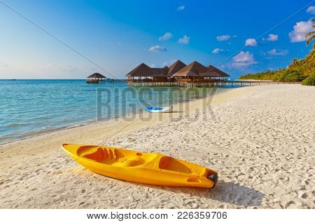 Boat on Maldives beach - nature vacation background