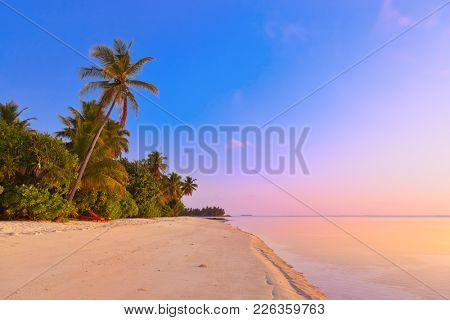 Sunset in Maldives beach - nature vacation background