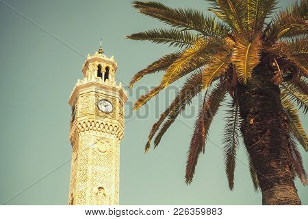 Clock Tower And Palm Tree On Konak Square. It Was Built In 1901 And Accepted As The Official Symbol
