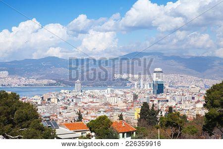 Izmir City Skyline, Turkey. Modern Buildings And Mountains On Background