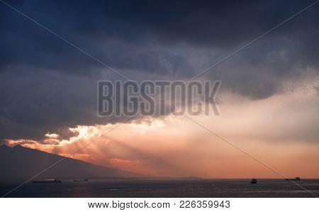 Evening Sunlight In Dark Stormy Clouds, Landscape Background Photo, Bay Of Izmir City, Turkey