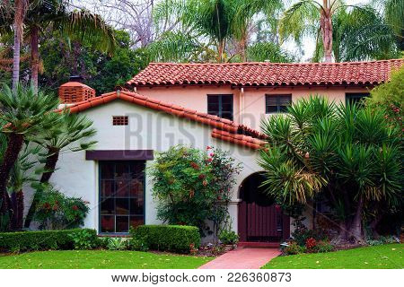 Historic Spanish Style Home With Manicured Landscaping Taken In A Residential Neighborhood