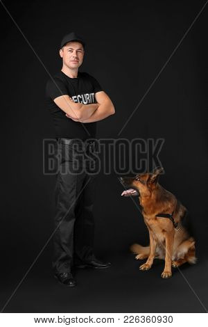 Security guard with dog on black background
