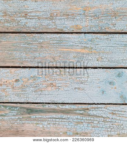 Vintage wood background with old cracky white paint