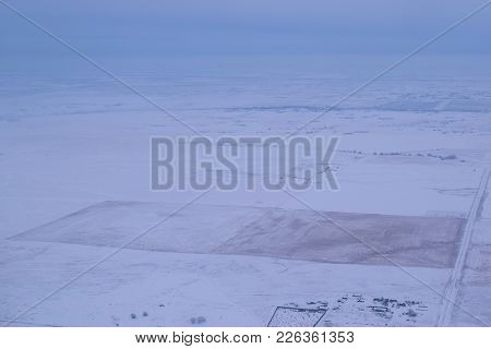 Great Plains Covered In Snow After A Blizzard Taken In The Rural North American Prairie