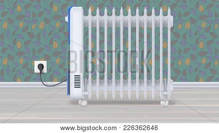 Oil Radiator In Room With Wallpaper. White, Electric Oil Filled Heater On Light Wooden Floor. Domest