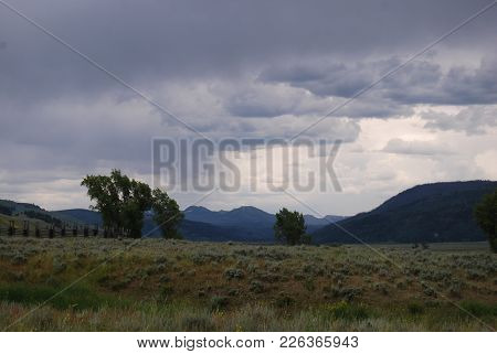 Storm Clouds And Rain Over The Vast Valley Of Yellowstone National Park