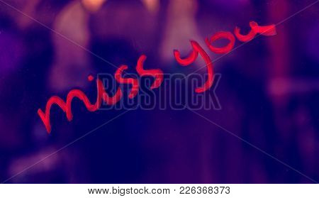 Conceptual photo of a sassy love, handwritten phrase miss you with a cheeky hint, Valentines day holiday background