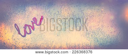 Find your love, abstract romantic background, vintage style photo of a handwritten word love on the wet window, romantic message for Valentines day