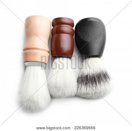 Shaving brushes for man on white background