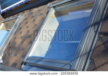 Attic Skylight Roof Windows On The Asphalt Shingles House Roof.