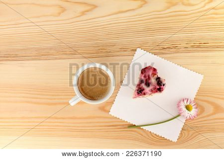 Flat Lay Of Cup Of Black Coffee And Berry Cake With Flower On The Table Top View / Sweet And Fragran