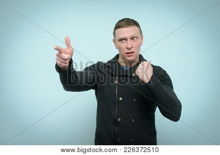 Angry Nervous Man Threatens Someone With His Fist And Is Showing Ahead By His Index Finger Isolated